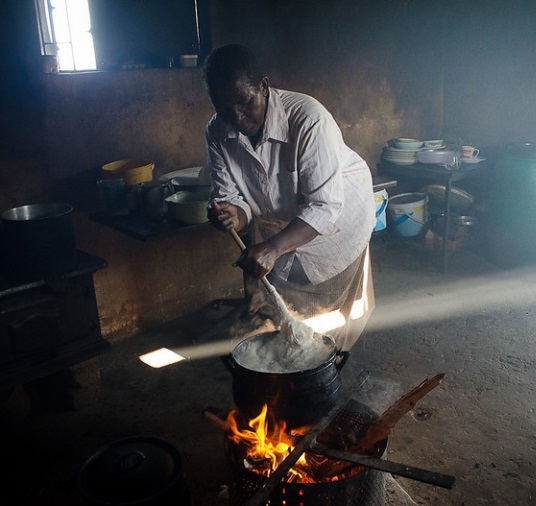 Cooking Mealie Meal cornmeal dish in South Africa