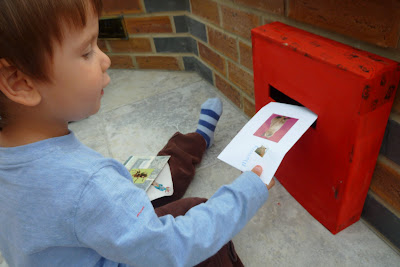 Child with homemade postbox