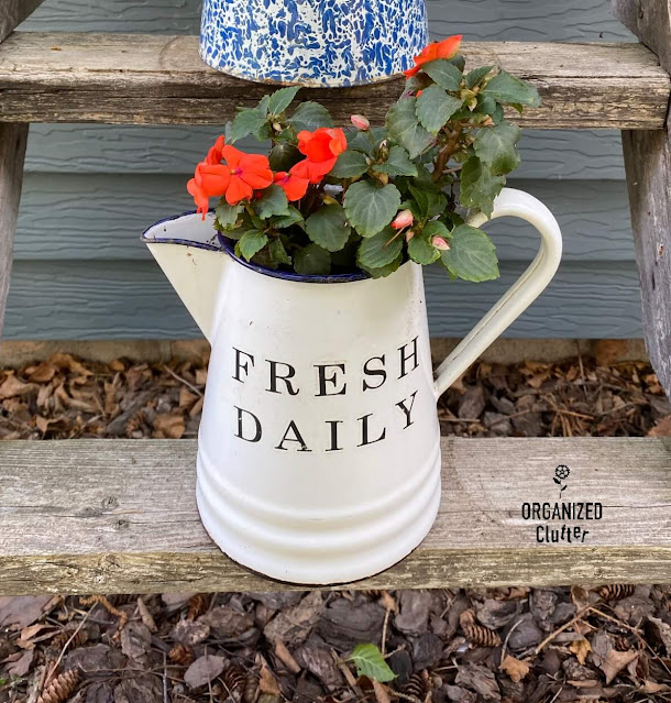 Photo of enamelware coffee pot with a Fresh Daily decor transfer on the front