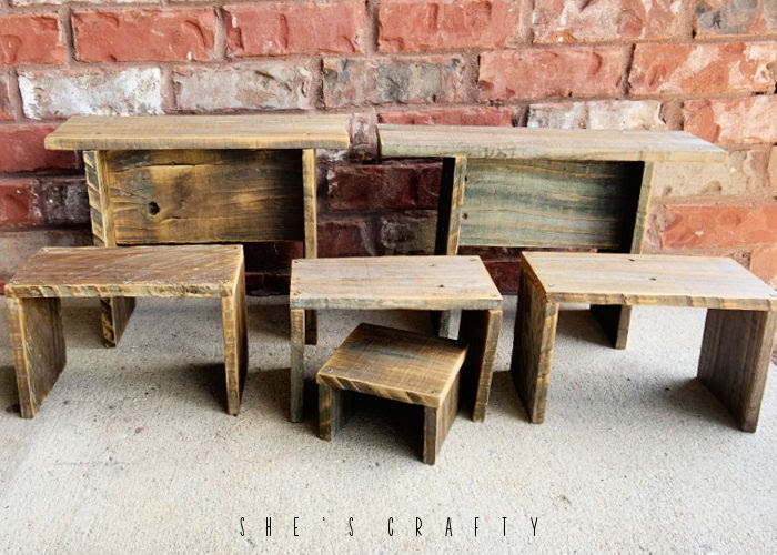 weathered wood stools and risers made from fence boards.