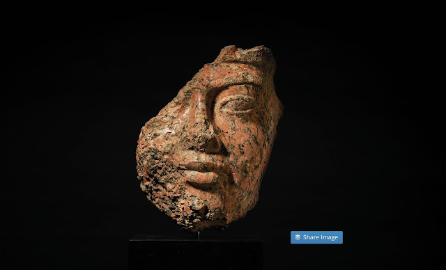 The partial fragment of King Amenhotep's statue or bust which is made of red granite