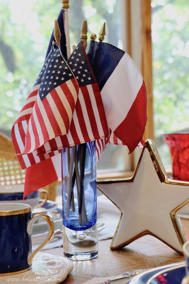 Labor Day patriotic French Country table setting with white ceramic star and French flag