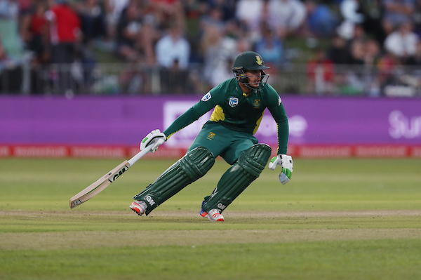Quinton de Kock of South Africa turns for a run