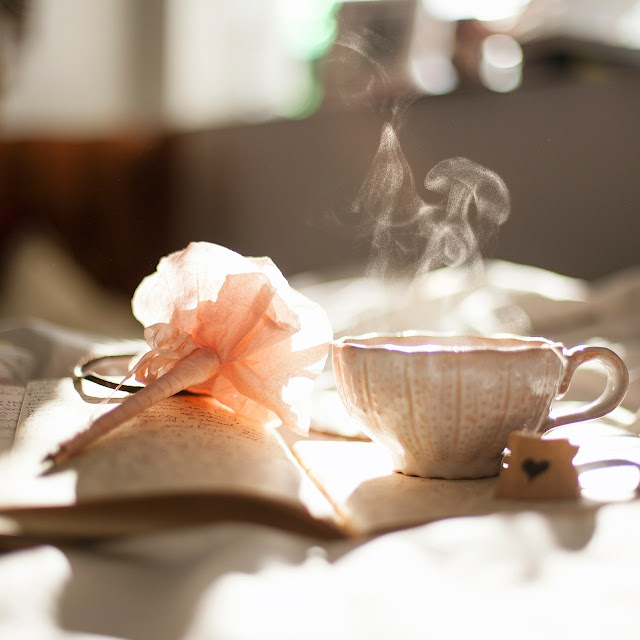 teacup flower and book