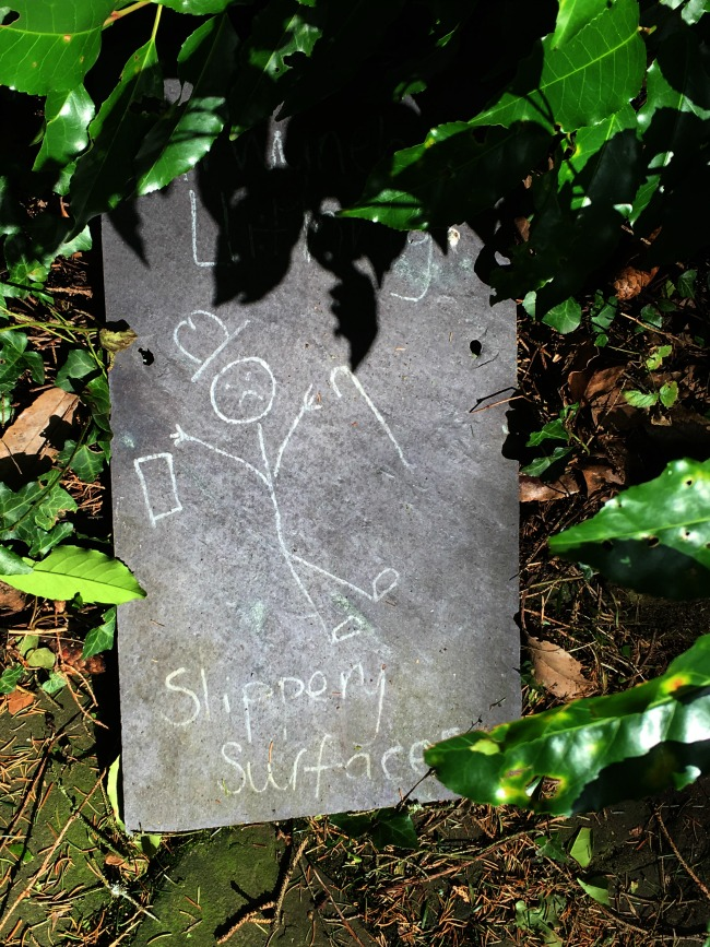 "comical sign ""slippery surface"" of stick man falling over dropping hat and walking stick"