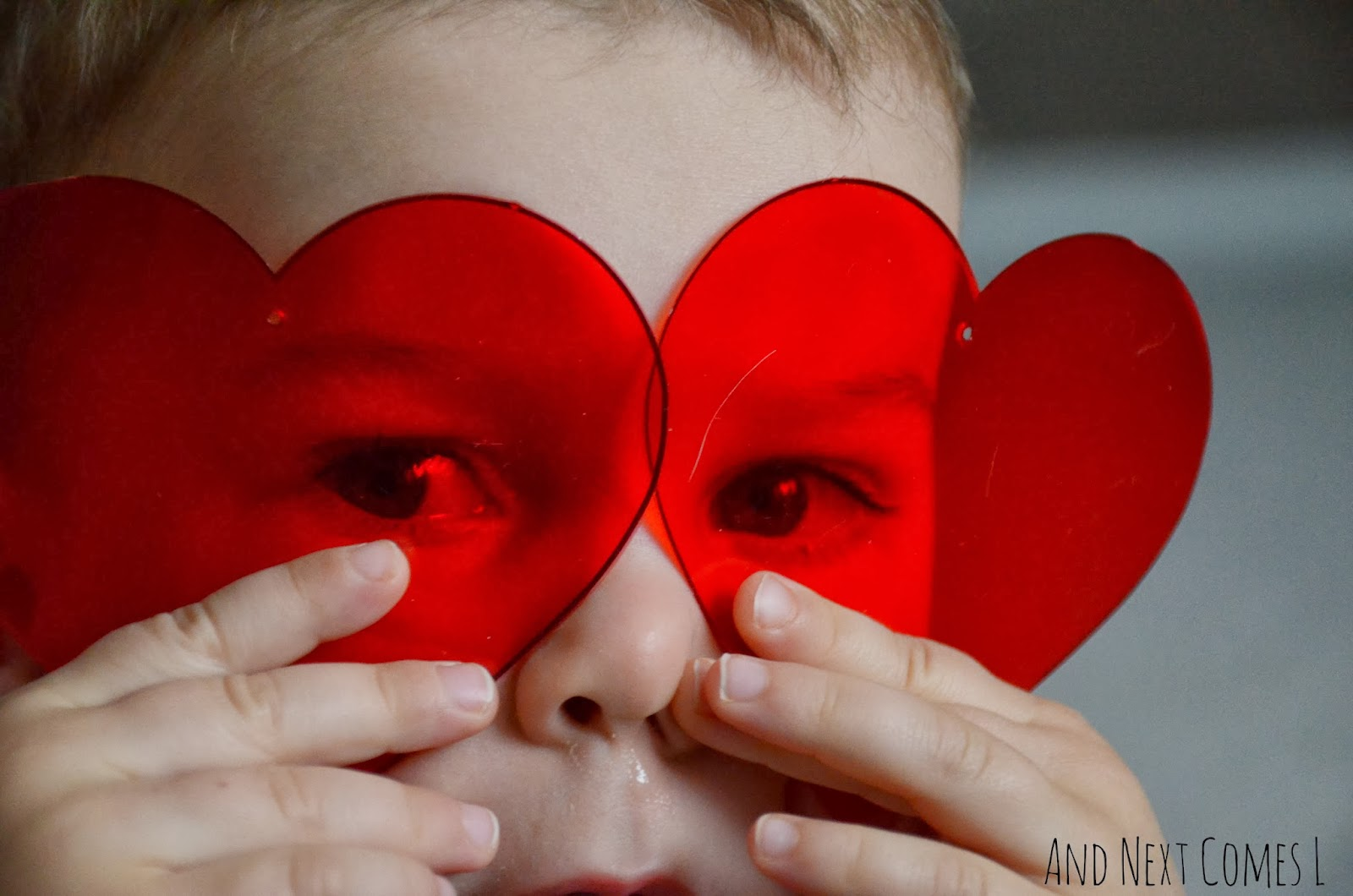 Toddler exploring transparent hearts