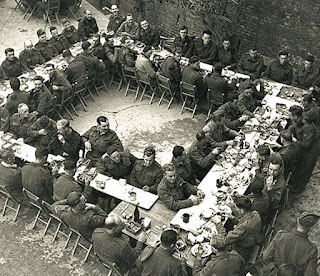 Soldiers enjoyed a Christmas dinner in the courtyard of the ruined church of Santa Maria di Constantinopoli