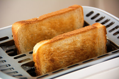 two pieces of white bread in toaster