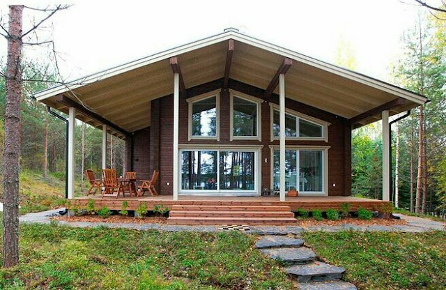 one story finnish house with a veranda