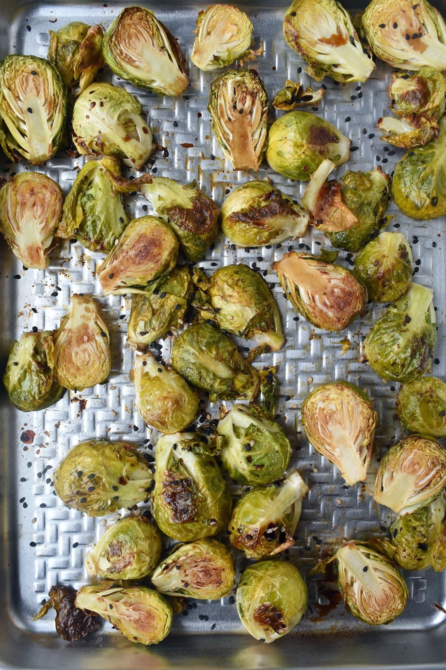 Asian Roasted Brussels Sprouts are loaded with garlic, onion and soy sauce flavors and are super crispy and delicious for the perfect side dish! #brusselssprouts #sidedish #asian #vegetables #healthy #cleaneating #roastedveggies