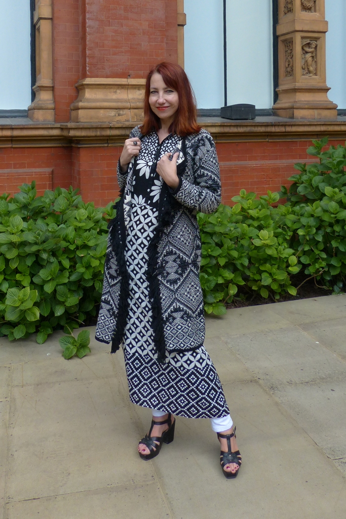 Black and white graphic pring maxi dress worn with printed cardigan and skinnies