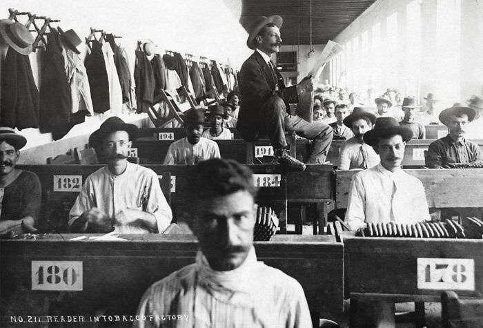 #30 A Hired Reader Reads To Cigar Makers Hard At Work In Cuban Cigar Factory (Ca. 1900-1910). Because Many Cigar Factory Employees Were Illiterate Lectors Were Hired To Read Novels, Poetry, Nonfiction Works, And Newspapers Determined By Consensus