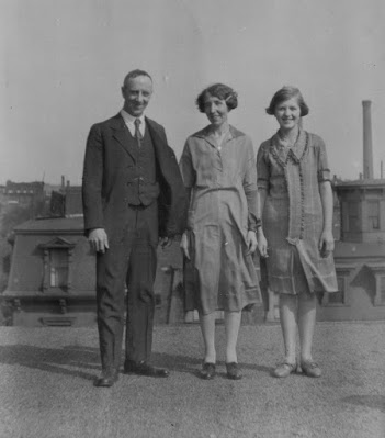 3 people standing on roof