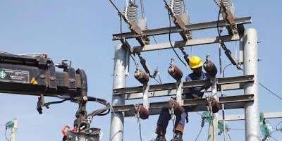 KPLC workers on a power transmission line. PHOTO | BDA
