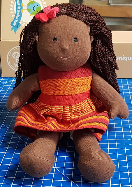 One Dear World Hearty Hope doll in orange red change of dress