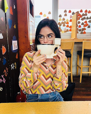 Lucy Hale drinking from toilet-shaped coffee mug at The Ddo-ong Cafe in Seoul, South Korea ('Poop Cafe')