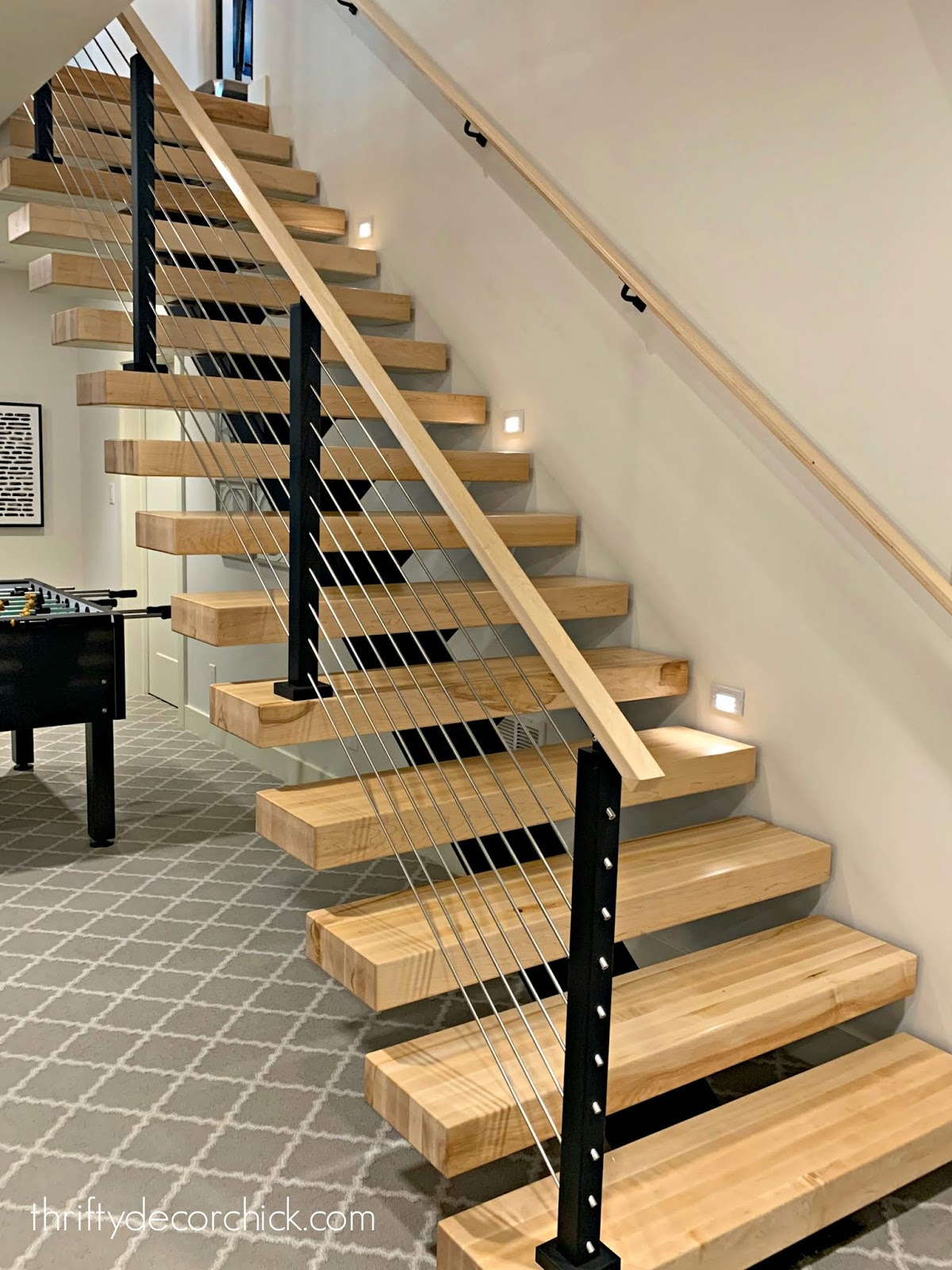 Modern open wood stairs with metal railings