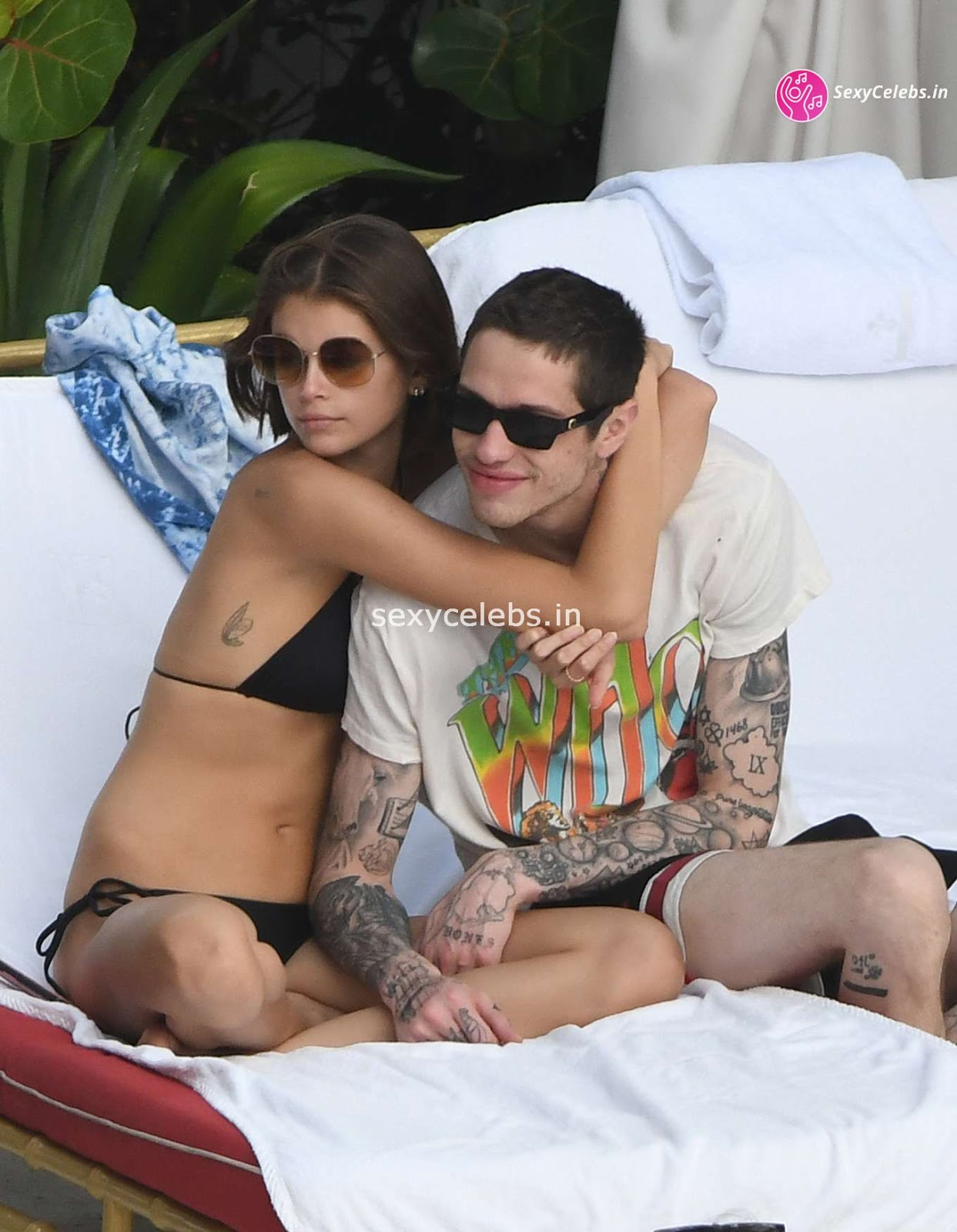 Kaia Gerber in tiny wet black bikini tongue kissing Pete Davidson in Miami Beach Pool