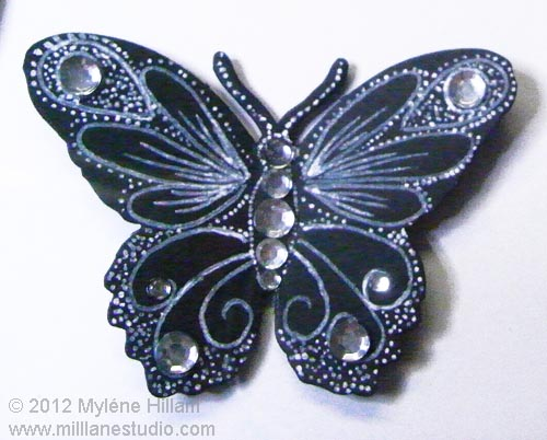 Vintage looking card stock butterfly with crystal detailing