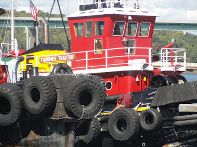 tugboat with truck tires mounted on it for pushing and bumping