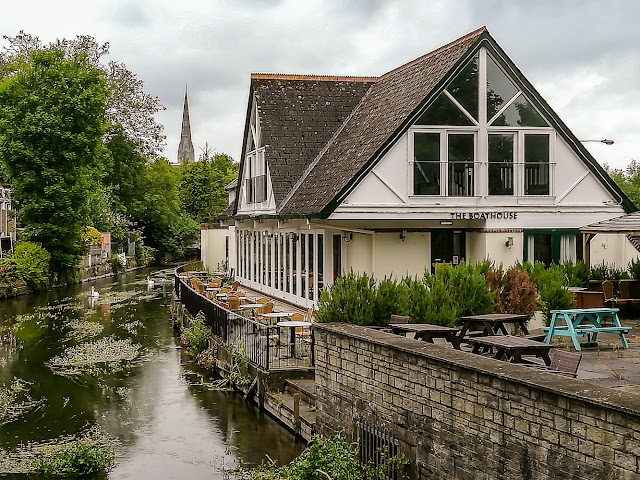 Photo of the Boathouse on the River Avon with the cathedral spire in the distance