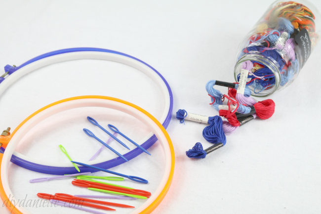 Supplies include plastic needles for children, plastic embroidery hoops and embroidery thread.