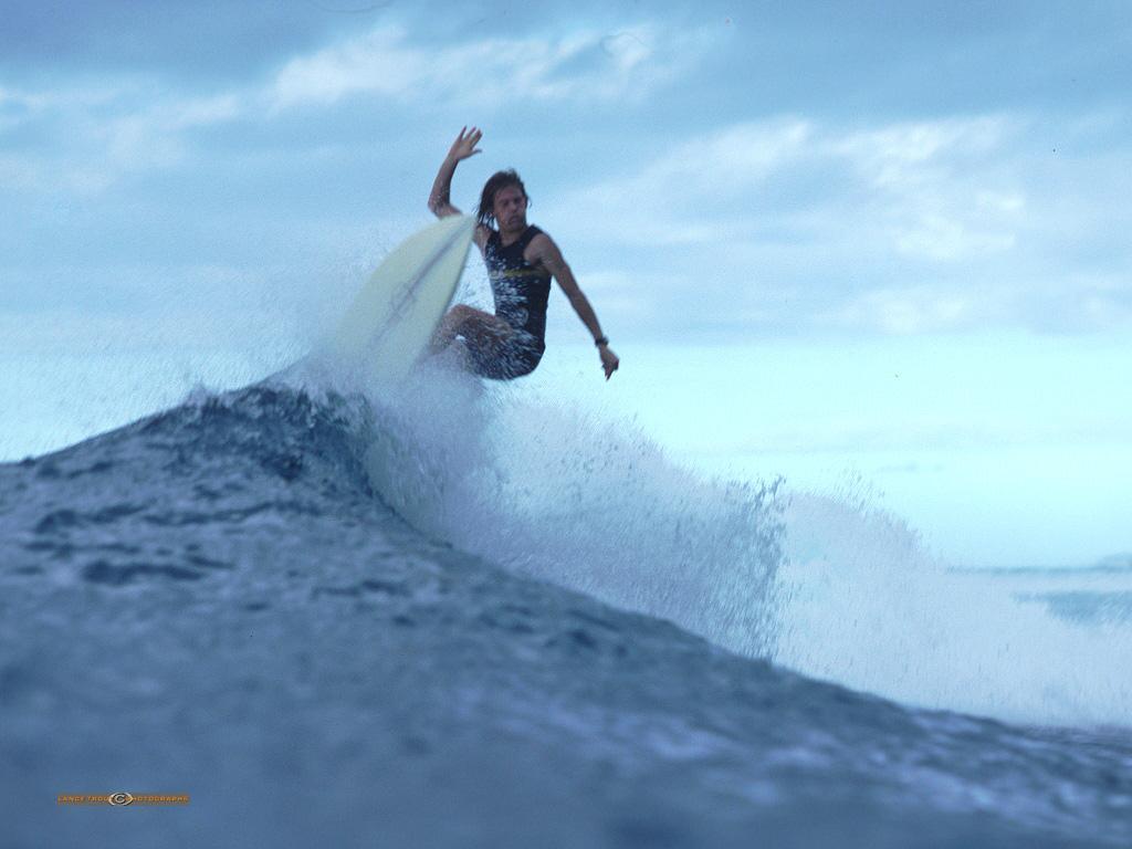 Lance Trout Photographs Surfing Thru The Rain