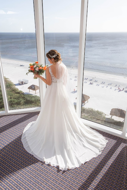 Bride with floral bouquet and tropical ocean views.