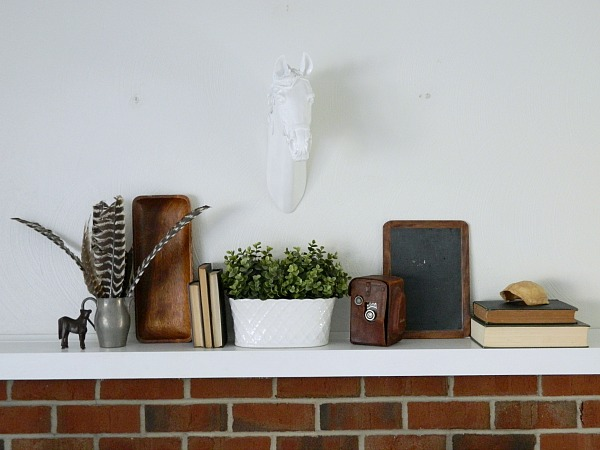 Create a Meaningful Spring Mantel with faux horse head taxidermy