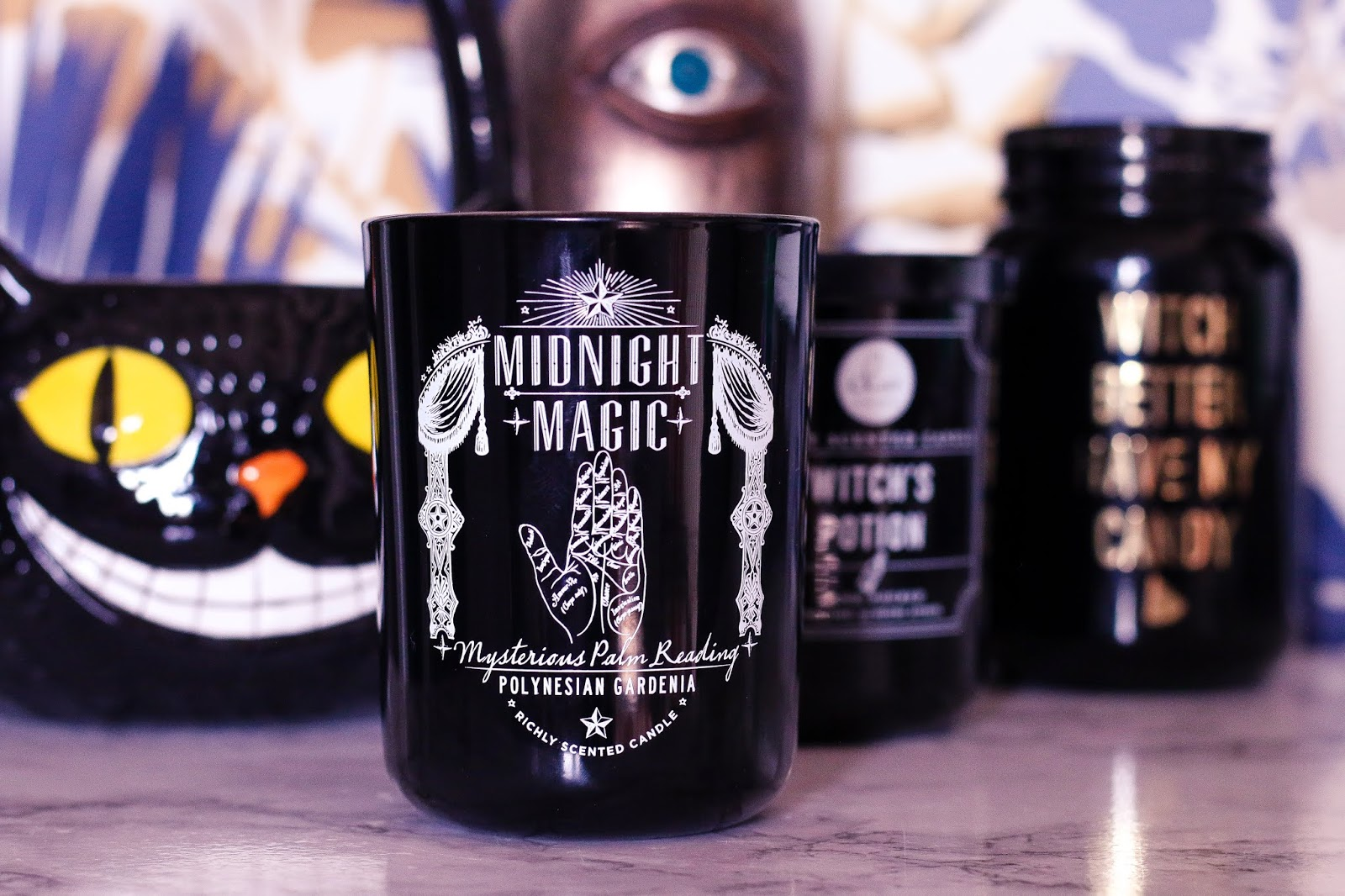 close up of a candle that had midnight magic printed on it with the illustration of a palm reading