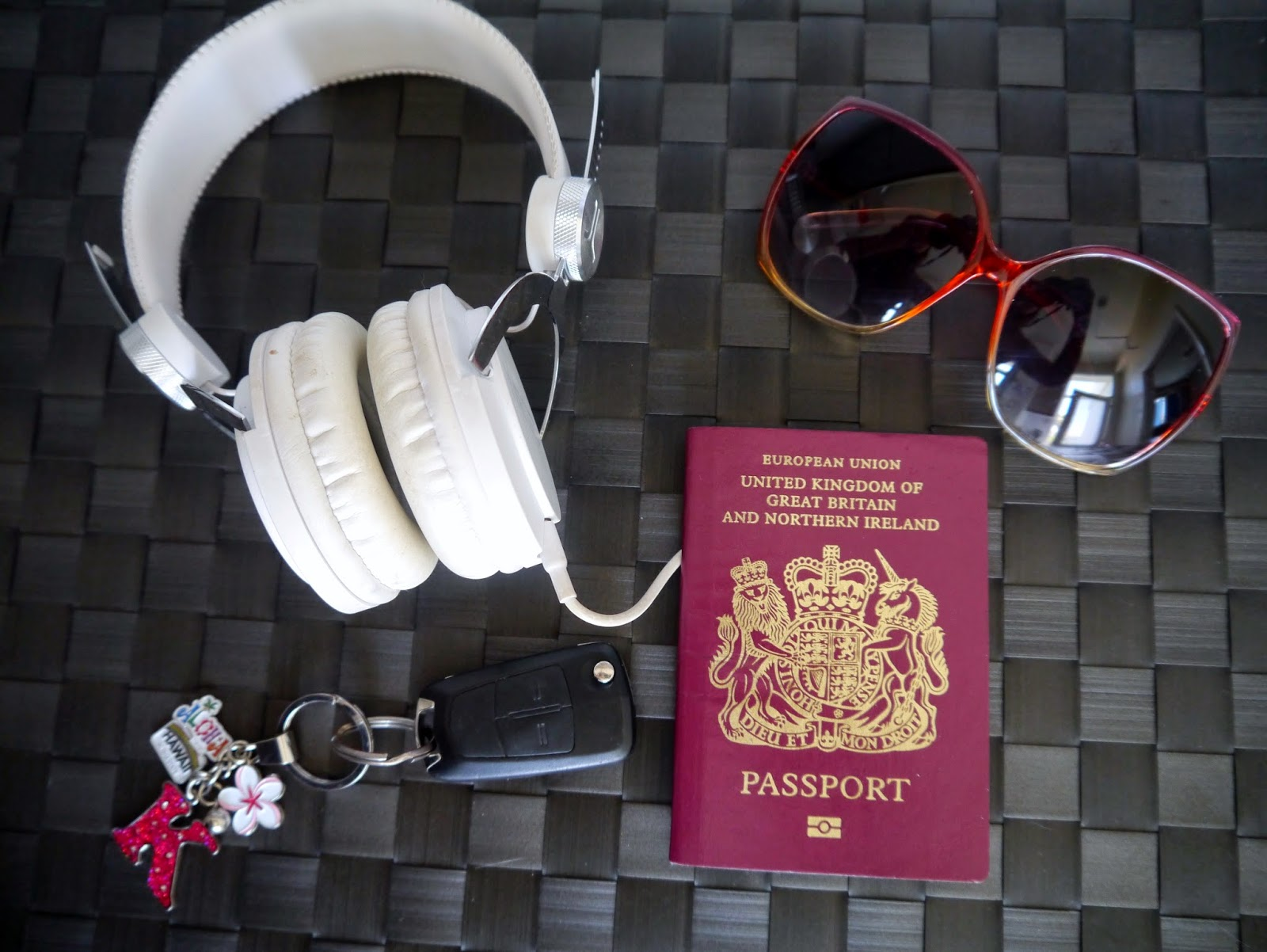 UK passport, keys and WESC headphones