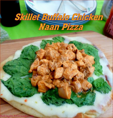 Skillet Buffalo Chicken Naan Pizza is a quick and easy one pan lunch or dinner that marries buffalo chicken, pizza and more. | Recipe developed by www.BakingInATornado.com | #recipe #cook