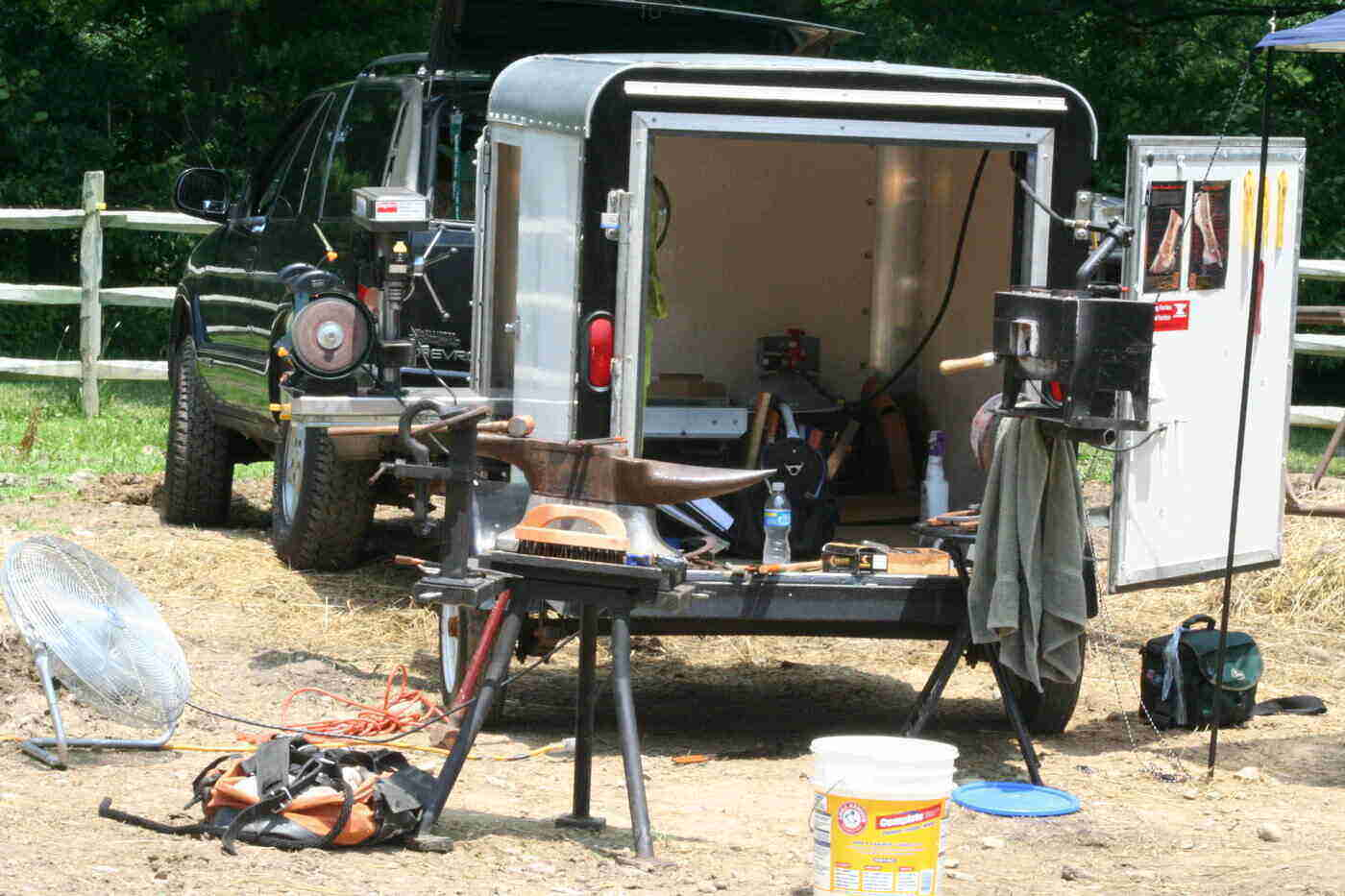 back of open farrier trailer with tools and supplies around - how to choose a farrier rig