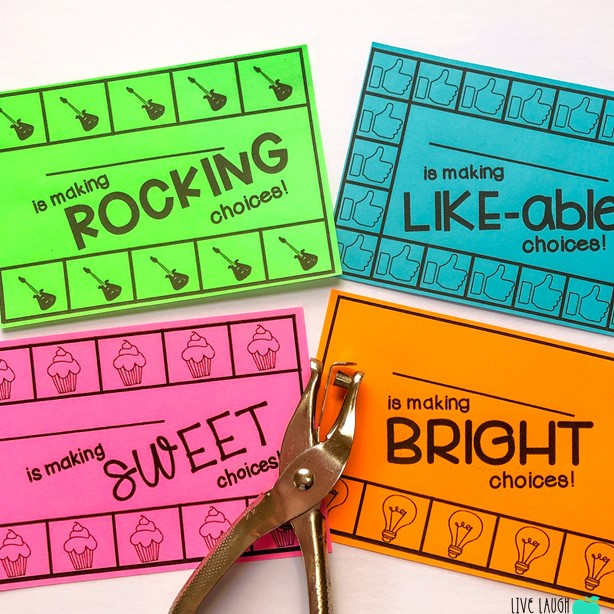 Image of 4 Colorful Behavior Punch Cards and a silver hole puncher