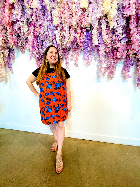 Jamie Allison Sanders enjoying the afternoon tea service and the flower wall at Morning Lavender in Orange County.