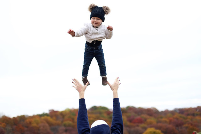 throwing baby in the air photos