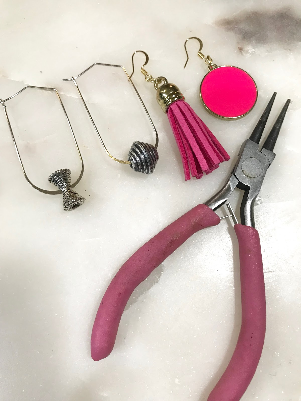 Image: The complete look of making earrings. Items used jump rings, earring hooks and needle nose pliers