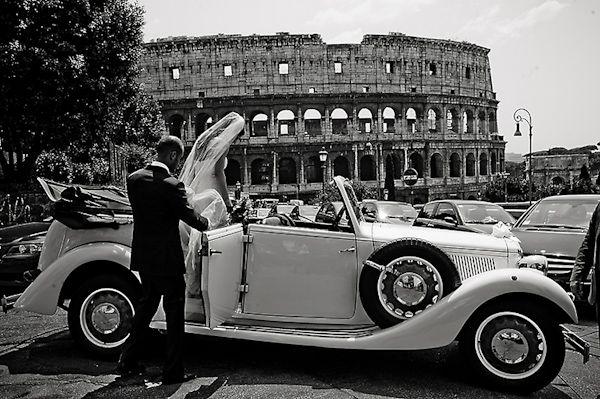 03 rome weddings image couple in vintage car outside coliseum