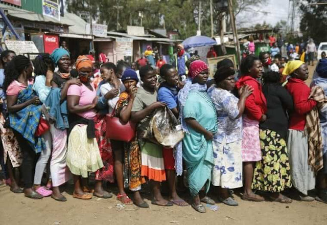Women queuing for food in Kibra despite COVID-19 social distancing calls. PHOTO | RMS