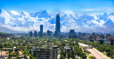 Santiago de Chile with snow-capped mountain range in the background.