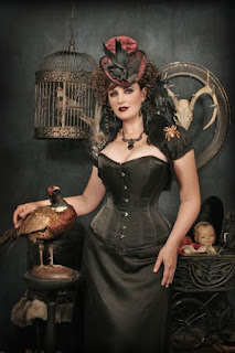 An example of the overbust corset in women's steampunk fashion. This woman wears her overbust corset with a black skirt, bolero jacket and hat.