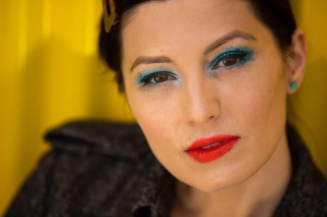Meryl Franzos, turquoise glitter, turquoise eyeshadow, orange lipstick