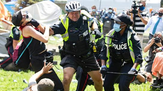 police homeless violence protesters Toronto brutality
