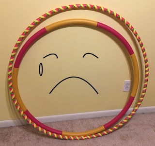 Hula hoops with drawn sad face