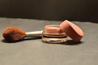 A compact with a brush