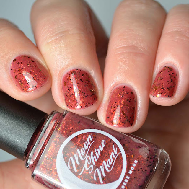 crimson nail polish with flakies