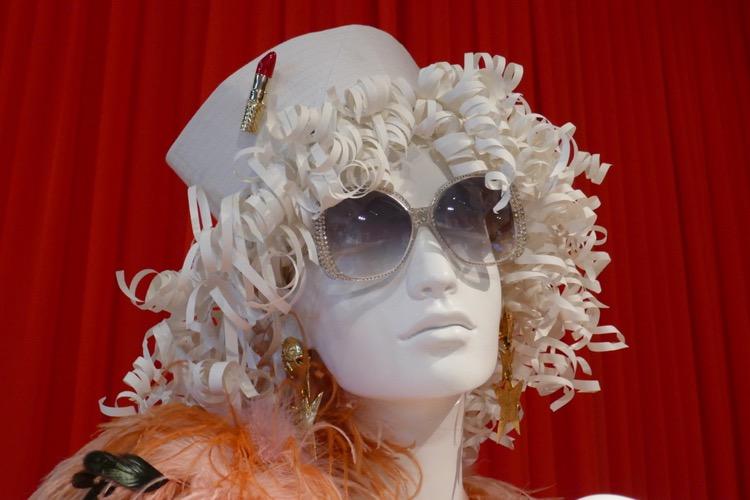Angel Pose season 1 hat and sunglasses