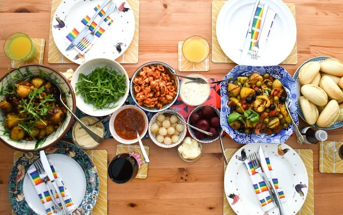 Family dinner table with a variety of dishes including balti potato bake