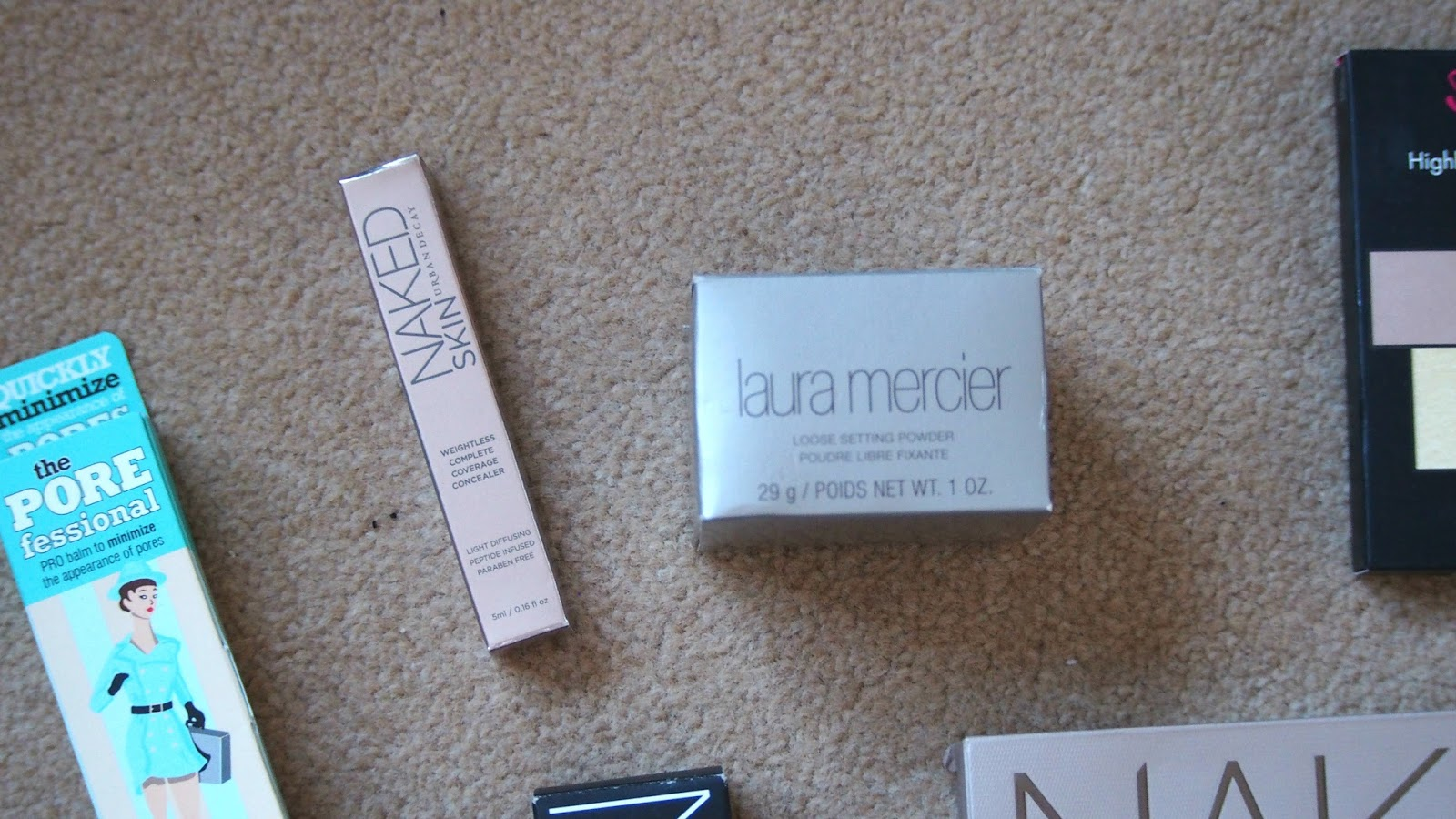 Urban Decay concealer and Laura Mercier Powder