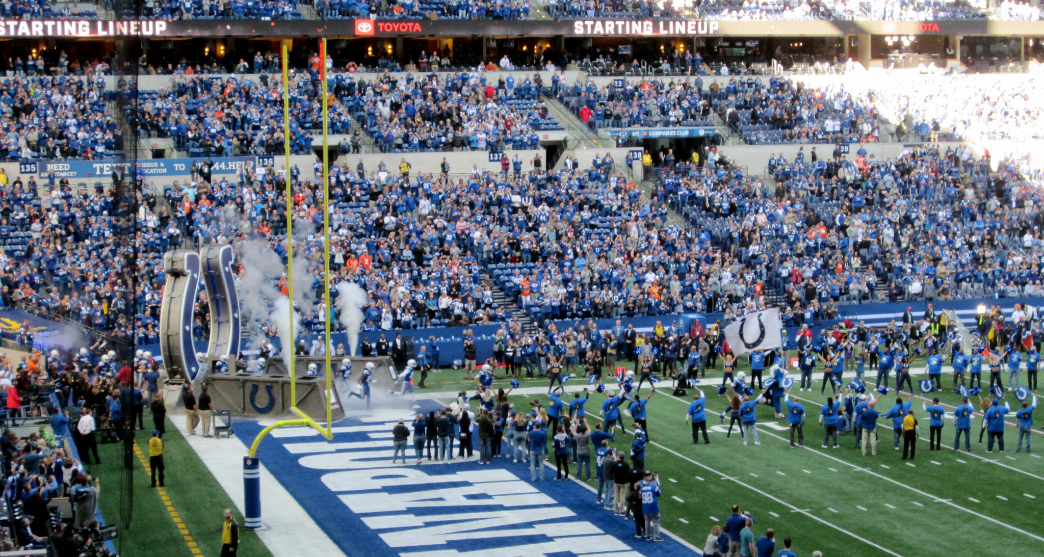 Indianapolis Colts players running onto the field before their game against the Denver Broncos